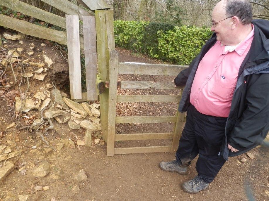 "Jonathan inspecting an ""unusual"" gate latch"