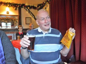 Peter enjoying a pint & chrisps